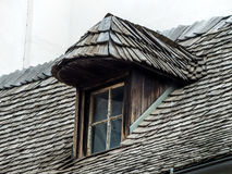 Old house with dormer and shingles Stock Photography