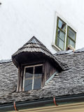 Old house with dormer and shingles Stock Images
