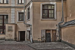 Old House. House with downpipes on the backstreet. High textured effect Stock Photo