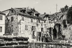 Old house with drying clothes in Split, Croatia, colorless Stock Image