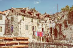 Old house with drying clothes in Split, Croatia, yellow filter Royalty Free Stock Image
