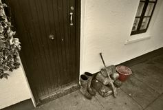 Old house exterior. With pair of wellingtons, hurling stick and bucket outside Stock Photo