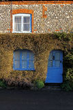 Old house exterior with topiary surround. Showing Stock Photos