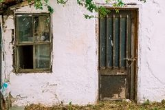 Old house facade. Old abandoned rustic house facade royalty free stock photo