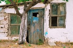 Old house facade. Old abandoned rustic house facade royalty free stock photography