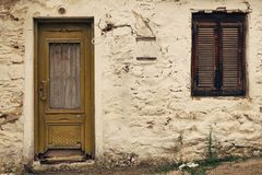 Old house facade. Old house window and door with rusty plaster royalty free stock photos
