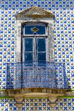 Old house facade. With Portuguese typical hand painted tiles stock image