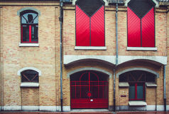 Old House facade with red shutters Royalty Free Stock Image