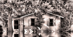 Old house in flood water. A HDR view in black and white of an old house in flood waters in Florida royalty free stock image