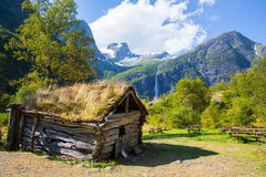 Old house at the foot of the mountain trolls Royalty Free Stock Image