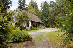 An old house in a forest Stock Images