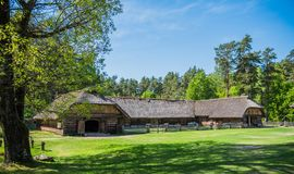 Old house in forest. Open-air ethnography museum in Latvia. Old house in forest. Open-air ethnography museum near Riga, Latvia royalty free stock photo