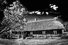 Old house in forest. Open-air ethnography museum in Latvia. Old house in forest. Open-air ethnography museum near Riga, Latvia stock images