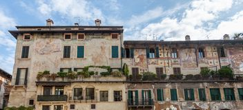 Old house with frescoes on the walls Case dei Mazzanti on Piazza Erbe in Verona, Italy royalty free stock photography