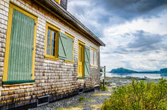 Old house in front of the bay Royalty Free Stock Images
