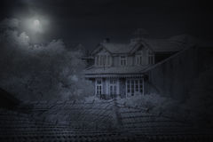 Old house in a full moon night Royalty Free Stock Images