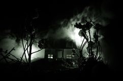 Old house with a Ghost in the moonlit night or Abandoned Haunted Horror House in fog. Old mystic villa with surreal big full moon. Horror Halloween concept royalty free stock photos