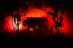Old house with a Ghost in the moonlit night or Abandoned Haunted Horror House in fog. Old mystic villa with surreal big full moon. Horror Halloween concept royalty free stock photography