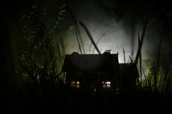 Old house with a Ghost in the moonlit night or Abandoned Haunted Horror House in fog. Old mystic villa with surreal big full moon. Horror Halloween concept royalty free stock images
