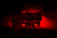 Old house with a Ghost in the moonlit night or Abandoned Haunted Horror House in fog, Old mystic villa with surreal big full moon. Stock Photos