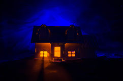 Old house with a Ghost in the moonlit night or Abandoned Haunted Horror House in fog, Old mystic villa with surreal big full moon. Royalty Free Stock Image