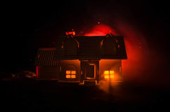 Old house with a Ghost in the moonlit night or Abandoned Haunted Horror House in fog, Old mystic villa with surreal big full moon. Royalty Free Stock Photography