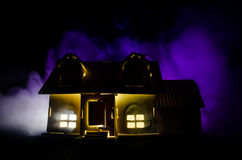 Old house with a Ghost in the moonlit night or Abandoned Haunted Horror House in fog. Old mystic villa with surreal big full moon. Stock Photos