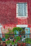 Old house in Greece. Front of an old house decorated with flower pots in Greece Royalty Free Stock Photo