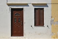 Old house in Greek style. Old facade of the building with a new door and window. Old house in Greek style Royalty Free Stock Photos