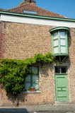 Old house with green door and windows. Royalty Free Stock Photo