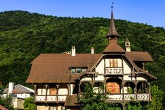 Old house in the green forest of Carpathian Mountains, Romania. Sunny day in Sinaia, Romania stock image