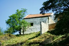 Old house and green tree in landscape Stock Photography