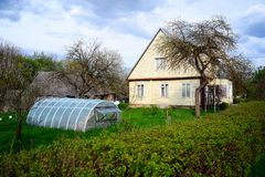 Old house and greenhouse in Viesintos town Royalty Free Stock Photos