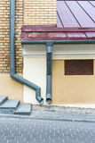 Old house with gutter and downspout Royalty Free Stock Photo