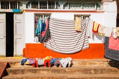 House and hanging laundry in Mysore, India. Old house and hanging laundry in Mysore, India Stock Photo