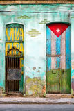 Old house in Havana with a painted cuban flag. Old shabby house in Havana with a cuban flag painted on its door and the words Viva Cuba royalty free stock image