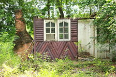 Old house. Home unoccupied windows resort tree wood wall stock photo