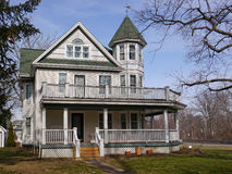 Old house with large porch Stock Photo