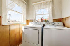 Old house laundry room interior with old fashioned appliances Stock Photos