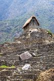 Old house in Machu Picchu. Mountains in the background stock photos