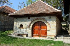 Old house made of stone with wooden door. Made for storing wine stock photos