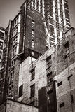 Old house in Manhattan. Old photo stylization Stock Images