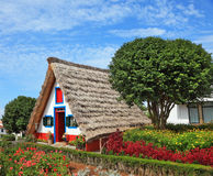 Old house-museum on the island of Madeira. Old house-museum of the first settlers on the island of Madeira. Charming white cottage with a thatched roof and gable Stock Photo
