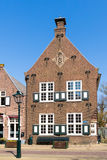 Old house in Naarden, Netherlands. Front facade of old house on Marktstraat street in historic town of Naarden, North Holland, Netherlands royalty free stock photography