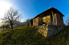 Old house near Danube river at sunset of autumn sunny day Stock Photos