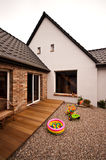 Old house new design architecture. An old house with new design renovation project - new elevation, neat pebble backyard and wooden panels terrace Royalty Free Stock Image