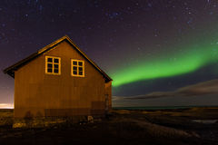Old house and Northern lights. Royalty Free Stock Photos