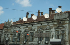 Old house occupied by satellite antennas Stock Images