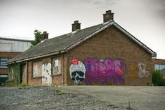 The old house. Old house laying empty with grafitti on walls Stock Images
