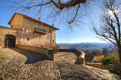 Old house over the village in Italy. Royalty Free Stock Images